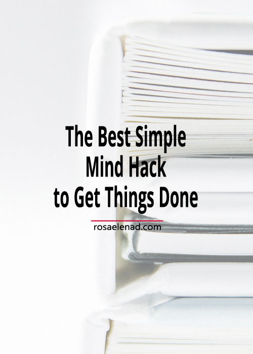 Pile of books with text overlay - The Best Simple Mind Hack to Get Things Done