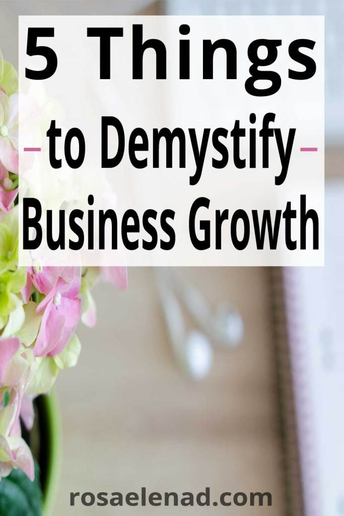 workplace with flowers and text overlay - 5 things to demystify business growth